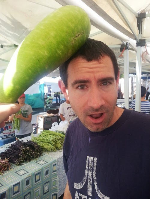 Here is an opo squash being used as a weapon. For reference, my boyfriend also has a long face, so this is a serious squash!