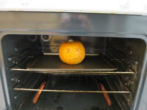 Step 2 - Into the oven you go, stabbed pumpkin corpse!